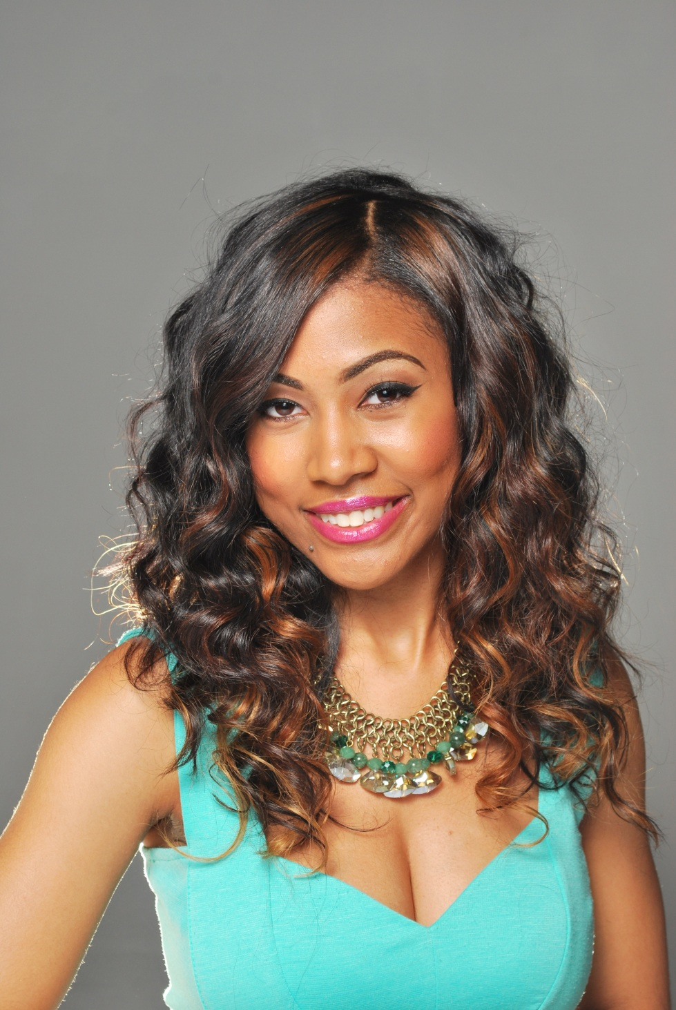 Natural hair styled with a curling wand